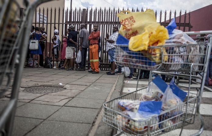 Customers queue to return Enterprise products in Germiston