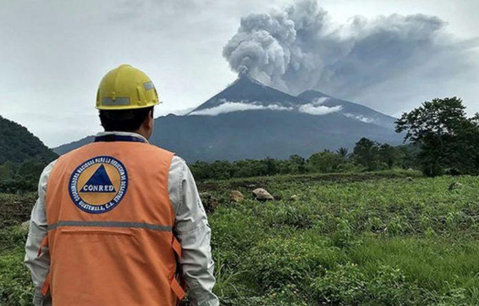 Photos taken near the Fuego volcano show the volcano spewing black smoke.
