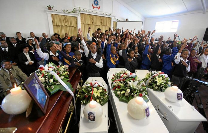 Transport tragedy: The mass funeral of the 14 Rheenendal Primary School pupils who were killed in bus crash near Knysna last year.