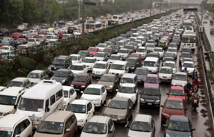 A traffic jam following power outage and rains at the Delhi-Gurgaon road on the outskirts of New Delhi