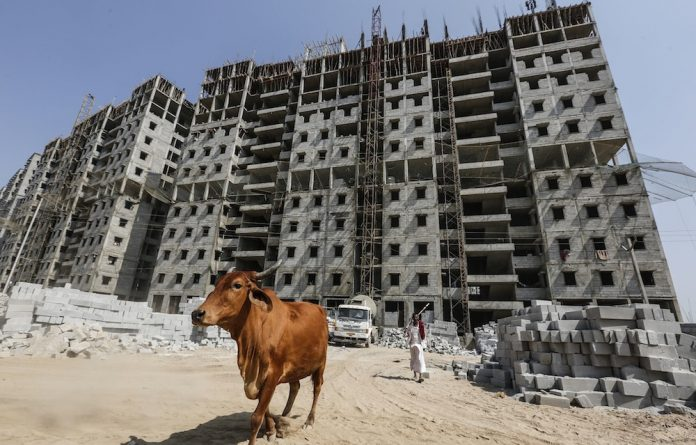 Fresh start: A residential building under construction on the outskirts of Ahmedabad