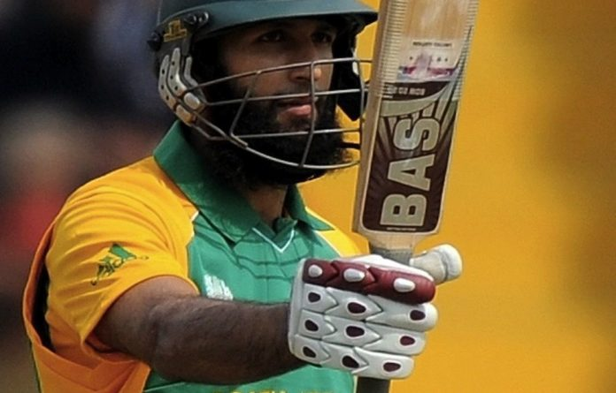 The Proteas' Hashim Amla takes to the field against Sri Lanka as South Africa's first permanent black skipper.