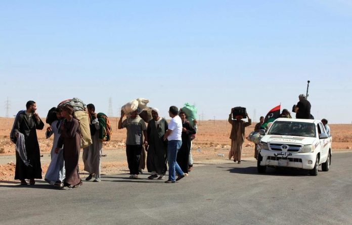 A feud between two Libyan towns demonstrates the country's deep divisions a year after Muammar Gaddafi was killed.