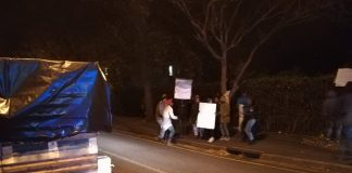 Social media posts showed police on the scene in Gardens to deal with a handful of protesters.