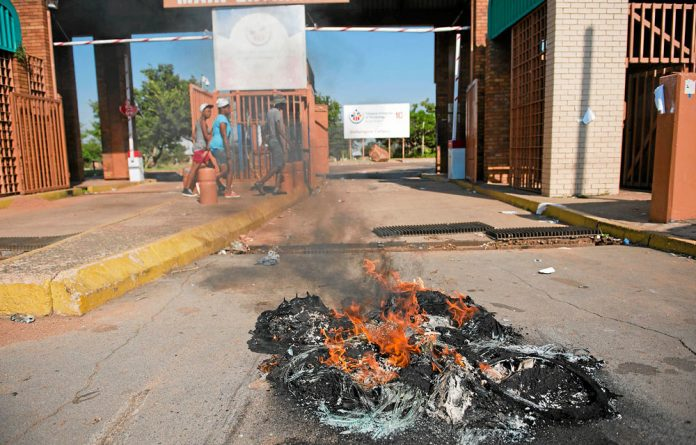 Opposite directions:Tyres burnt in protests at the Tshwane University of Technology.