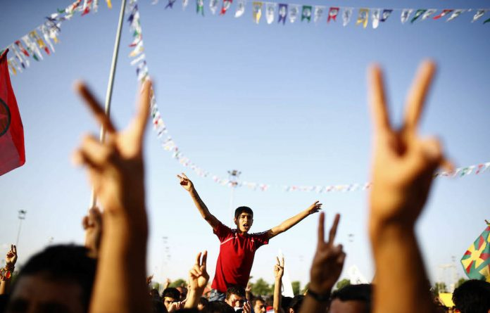 People's Democratic Party supporters celebrate the party's election wins that will prevent the Justice and Development Party of President Recep Tayyip Erdogan and Prime Minister Ahmet Davutoglu from dominating Parliament.