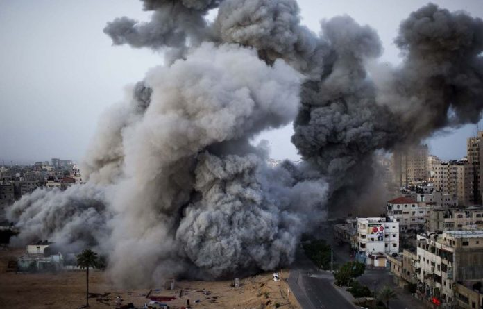 Smoke rises after Israeli missiles strike Gaza City.