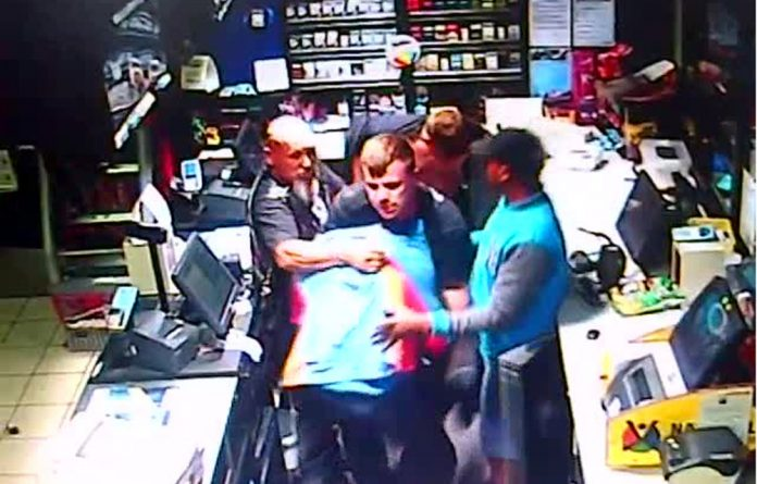 Police are investigating a case of assault after what appears to be a racially-motivated attack on a petrol attendant by a group of bikers.