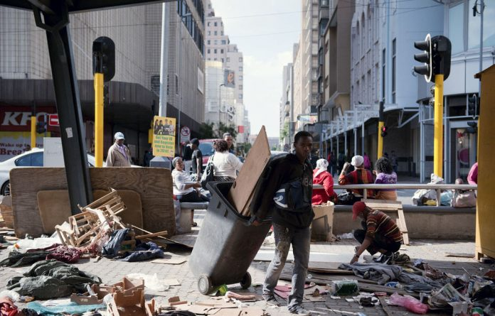 Traders pack up at the corner of Joubert and President streets.