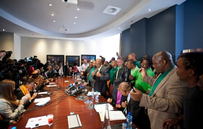 Amcu executives celebrate signing the agreement that ends the five-month strike.