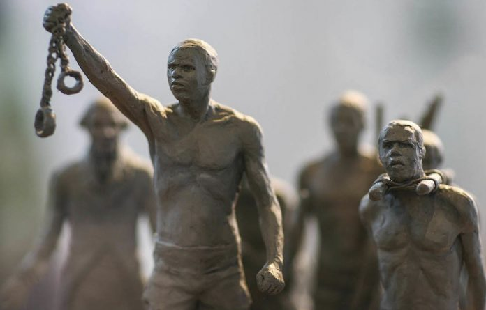 A model of a statue to be erected in London's Hyde Park to mark Britain's abolition of slavery in 1834. Fourteen Caribbean nations are suing Britain for reparations over slavery.