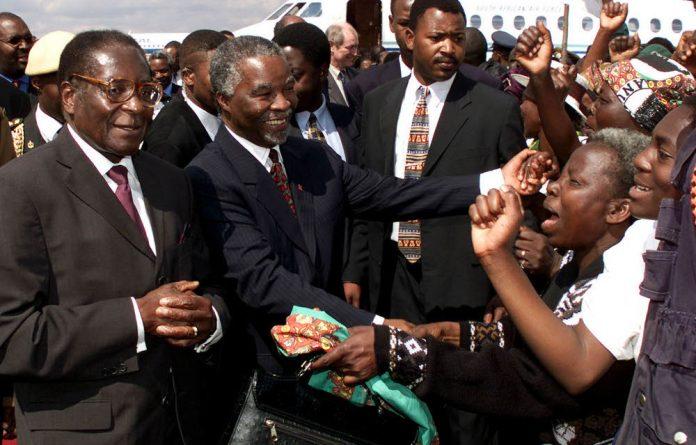 Zimbabwean President Robert Mugabe and then-president Thabo Mbeki in 2000.
