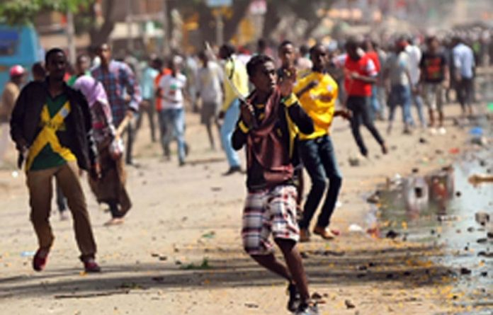 Somali youth armed with machettes and crude weapons fight during inter-ethnic clashes in Nairobi's Eastleigh suburb.