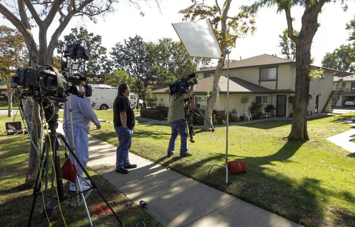Members of the media gather outside the home of Miguel Alejandro Santana Vidriales