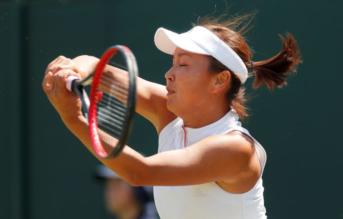 Peng Shuai of China in action during her first round match against Samantha Stosur of Australia.