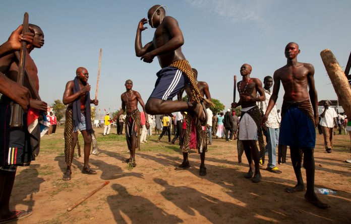 Southern Sudanese men dance in Juba to celebrate their country's first independence anniversary.
