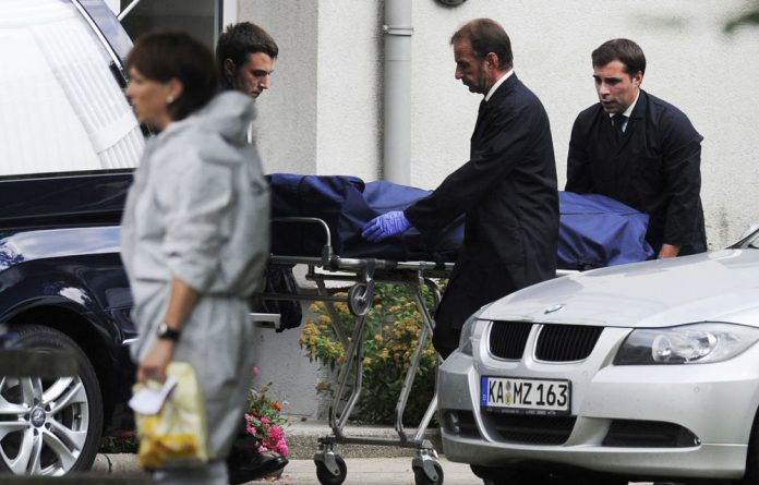 A body is carried away after the hostage-taking in Karlsruhe