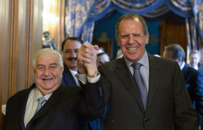 Getting to grips: Syrian Foreign Minister Walid al-Muallem has support from his Russian counterpart Sergei Lavrov at the talks.