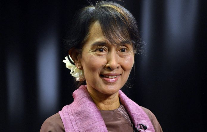 Burma democracy icon Aung San Suu Kyi smiles during her visit to the BBC.