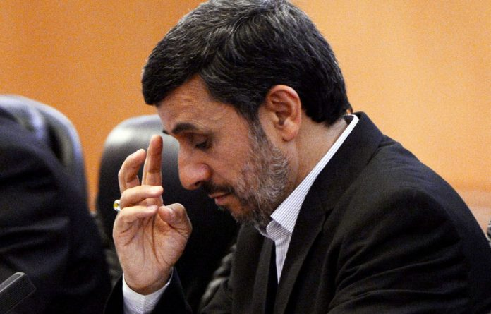 Iranian President Mahmoud Ahmadinejad at a bilateral meeting with Chinese President Hu Jintao in Beijing on Friday.
