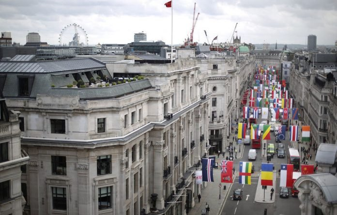 Flags of 200 nations are displayed on Regent Street in London