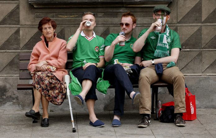Irish fans drink beer ahead of the Euro soccer championship in Gdansk. An African has to work three hours on average to afford a beer