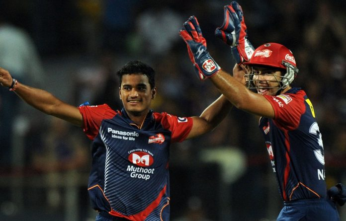 Delhi Daredevils' Pawan Negi and Naman Ojha celebrate the wicket of unseen Kolkata Knight Riders batsman Brendon McCullum during their IPL Twenty20 playoff.