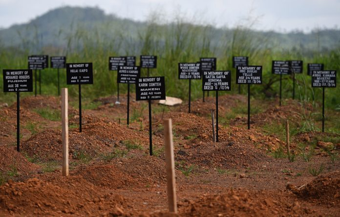 Tombstones at a cemetery at the Kenama Ebola treatment center in Sierra Leone