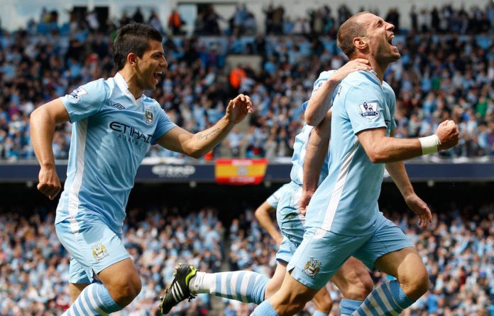 Manchester City's Pablo Zabaleta and Sergio Aguero celebrate Zabaleta's goal during their English Premier League soccer match against Queens Park Rangers in Manchester.