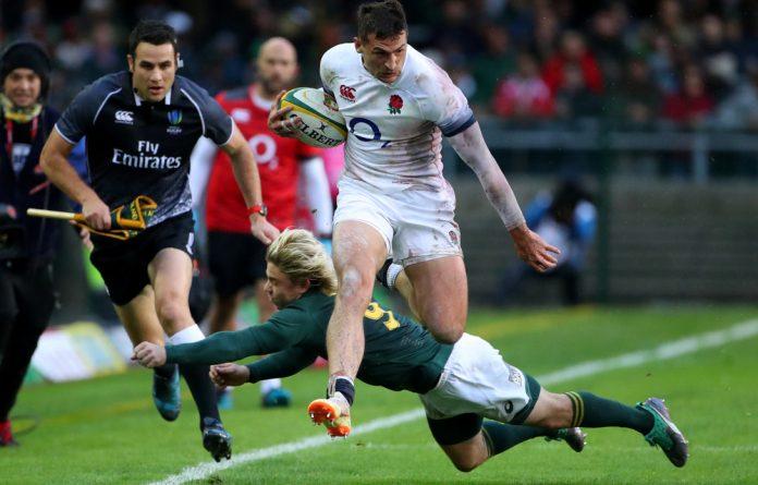 England's Jonny May is tackled by South Africa's Faf de Klerk.