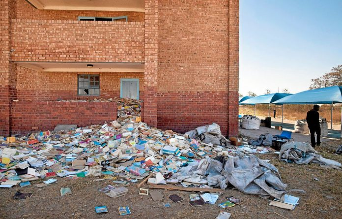 Trashed textbooks the education department says are unusable.