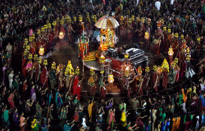 Hindu devotees perform Garba