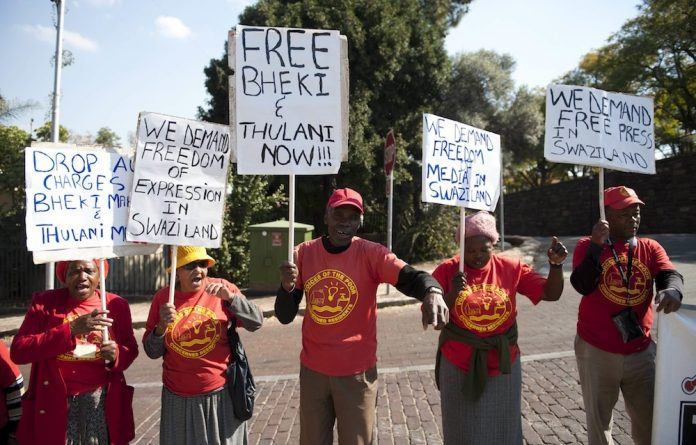 Speaking out: Campaigners protest against the jailing of two journalists outside the Swaziland embassy in Pretoria.