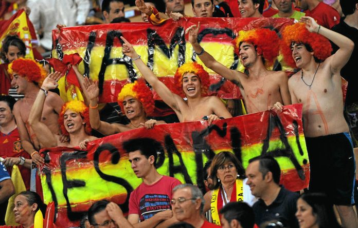 Crowd control: Spanish fans are ready to celebrate another tournament victory.