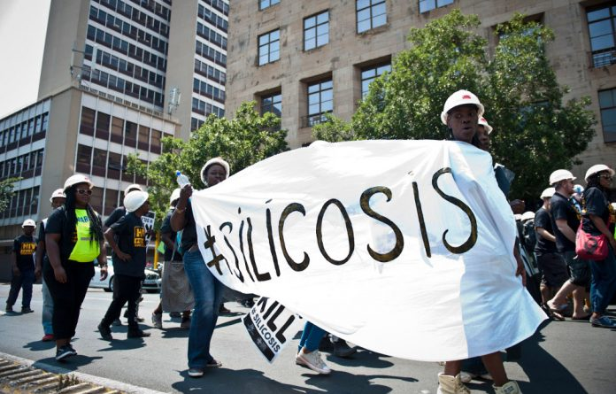 Protesters call for mineworkers afflicted with silicosis to be compensated.