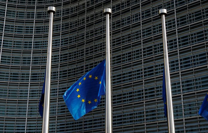 A European Union flag is seen outside the EU Commission headquarters in Brussels.