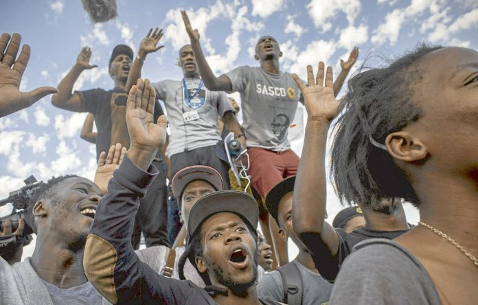 UCT students cheer after the statue of Cecil John Rhodes is removed from their campus. Is this a symbolic victory or will black academics really see a reassessment of the reality in higher education?