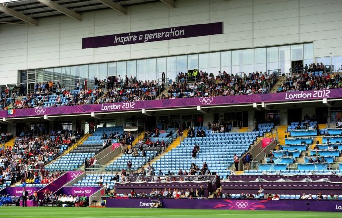 Empty seats in the main stand during the London 2012 Olympic men's football match between Gabon and Mexico at The City of Coventry Stadium in Coventry