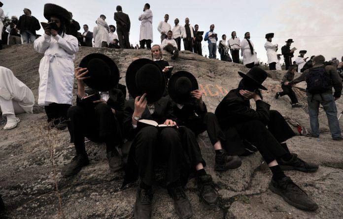 Ultra-Orthodox Jewish men pray in the small Ukrainian city of Uman.
