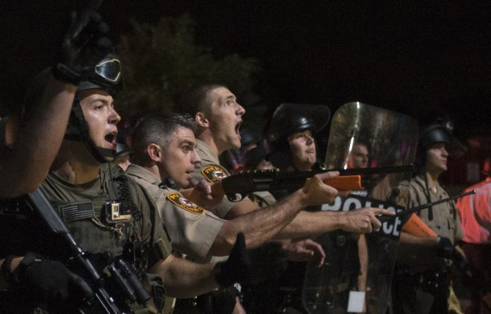 The US National Guard is on hand to support Ferguson police in case of violence after a grand jury decides whether to indict a white police officer who fatally shot an unarmed black teen.