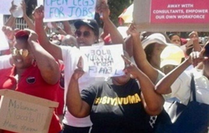 National Student Financial Aid Scheme workers protested outside their offices in Wynberg