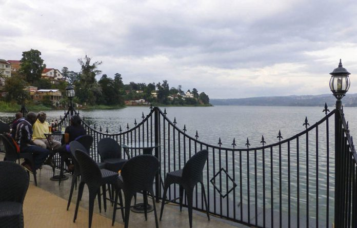 Guests enjoy the view of Lake Kivu from the veranda of the newly built Panorama Hotel.
