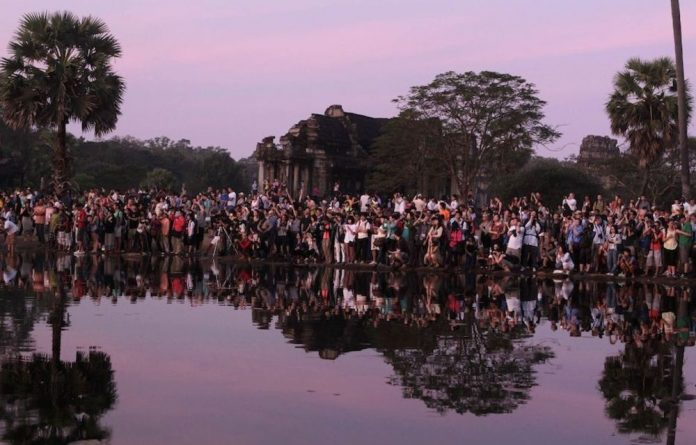 Hordes of people trying to make a unique photo at Angkor Wat.