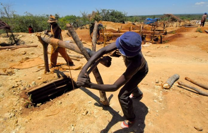 Subsistence diggers scraping a living outside the mining capital of Lubumbashi said they hoped Sunday's long-delayed poll will bring political change and a better life.
