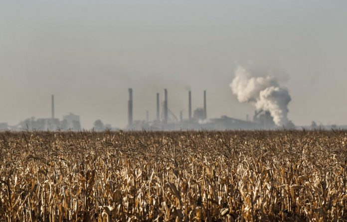 Poisonous: Pollutants spew out of ArcelorMittal's chimneys at its Vanderbijlpark steelworks and its waste dump seeps toxins into the ground.
