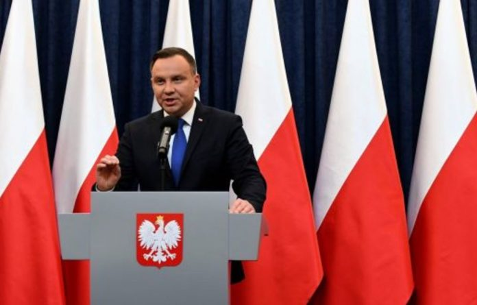 Poland's President Andrzej Duda speaks at a press conference in Warsaw to announce that he will sign into law a controversial Holocaust bill which has sparked tensions with Israel