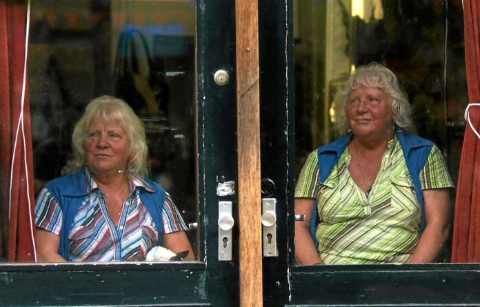 A window on their world: The Fokkens sisters have almost 100 years of experience in prostitution between them.
