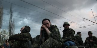 A column of Ukrainian men are blocked by armed pro-Russia supporters in the eastern Ukrainian city of Kramatorsk.