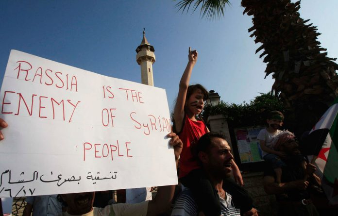 Protesters chant slogans against the Syrian regime and Russia's support of President Bashar al-Assad.