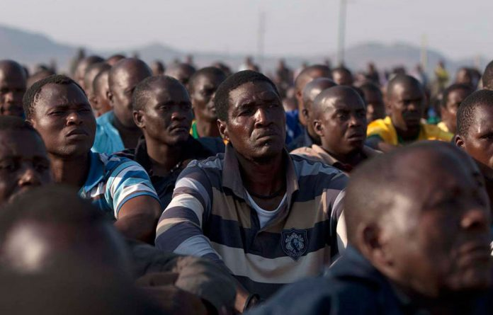 The crowd of miners at Wonderkop village appeared calm after being addressed by Julius Malema